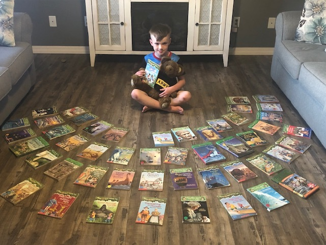 Boy with Magic Tree House Books